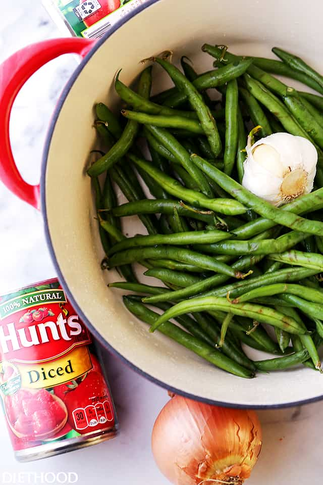 Fresh green beans and garlic in a pot