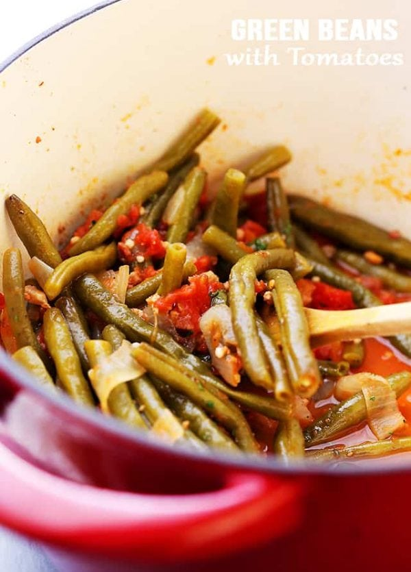 Green Beans and Tomatoes Recipe – Slow cooked green beans with tomatoes, onions and garlic. This easy, yet incredibly flavorful recipe makes for a perfect side dish to any main course.
