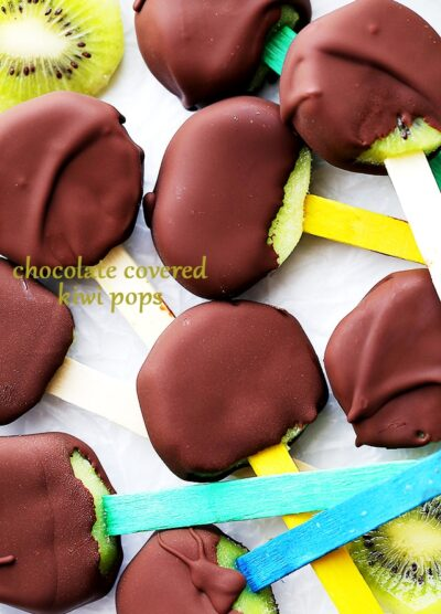Chocolate Covered Kiwi Pops - Delicious and easy to make healthy snack with kiwi fruit slices dipped in melted chocolate.