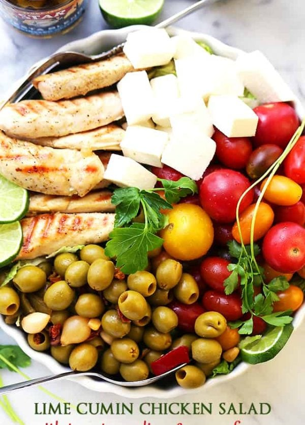 Lime Cumin Chicken Salad with Tomatoes, Olives and Queso Fresco - A huge bowl of flavor-packed, colorful, healthy chicken salad with tomatoes, fiesta blend olives and Mexican cheese.