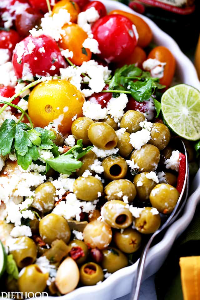 Lime Cumin Chicken Salad with Tomatoes, Olives and Queso Fresco - A huge bowl of flavor-packed, colorful chicken salad with tomatoes, fiesta blend olives and Mexican cheese.