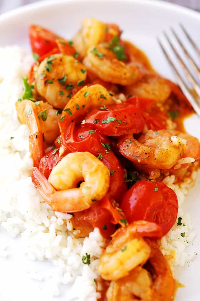 Spicy Garlic Shrimp and Tomatoes Sauté - A quick and easy way to make the most delicious accompaniment to rice, orzo, and pasta!