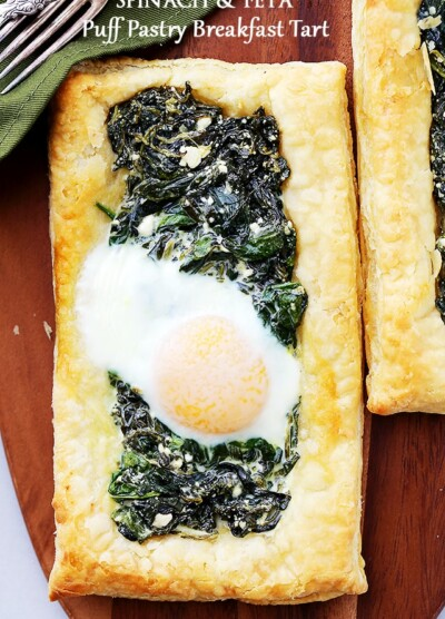 Spinach and Feta Puff Pastry Breakfast Tart Recipe - In just a few minutes of prep time, you can have this ridiculously easy, yet incredibly flavorful golden puff pastry topped with spinach, feta, and eggs. Perfect for breakfast, brunch, or even as an appetizer.