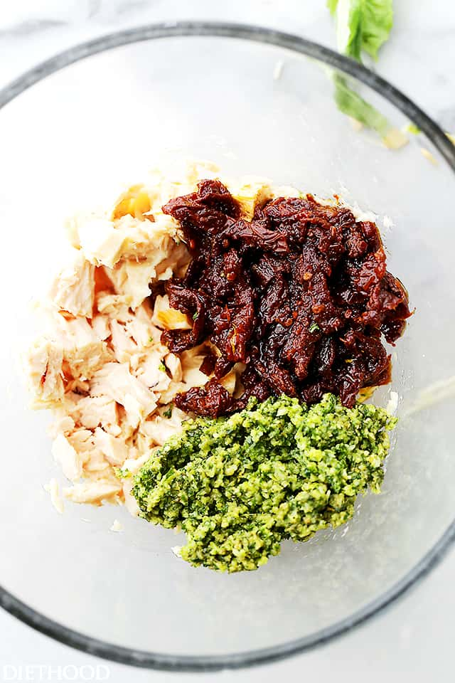 Sun Dried Tomatoes and Basil Pesto Tuna Salad - Combined with delicious basil pesto and flavorful sun dried tomatoes, this tuna salad is about to become your next favorite salad recipe that is perfect for any summer barbeque or just for lunch!