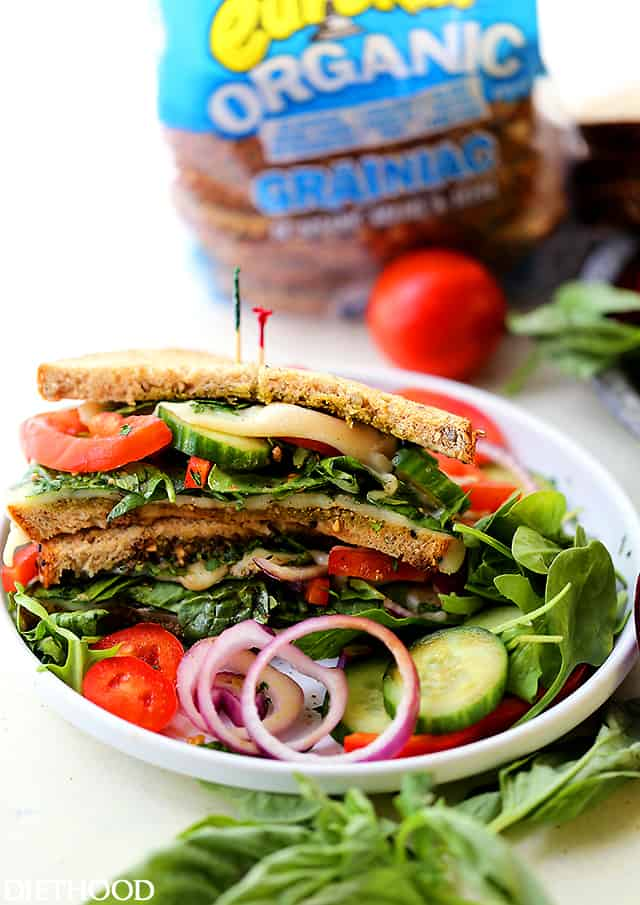 Panzanella Sandwich - Inspired by the classic Italian Panzanella Salad, this incredibly delicious sandwich is piled with layers of summer vegetables, basil pesto, and mozzarella cheese.