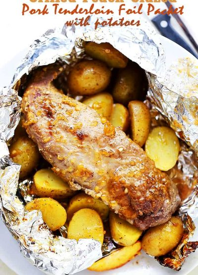 Grilled Peach-Glazed Pork Tenderloin Foil Packet with Potatoes - Glazed with peach preserves and flavored with a hint of garlic, this easy to make meat and potatoes dinner in a foil packet is impressive, incredibly delicious, and since it's grilled in foil packs, cleanup is a snap!