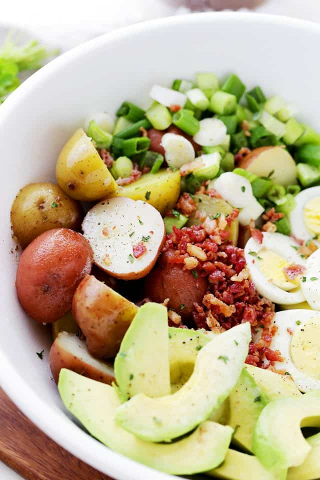 Lightened-Up Creamy Potato Salad Recipe - Whip up this lightened-up creamy potato salad packed with eggs, avocado and turkey bacon for your next summer picnic or barbecue!