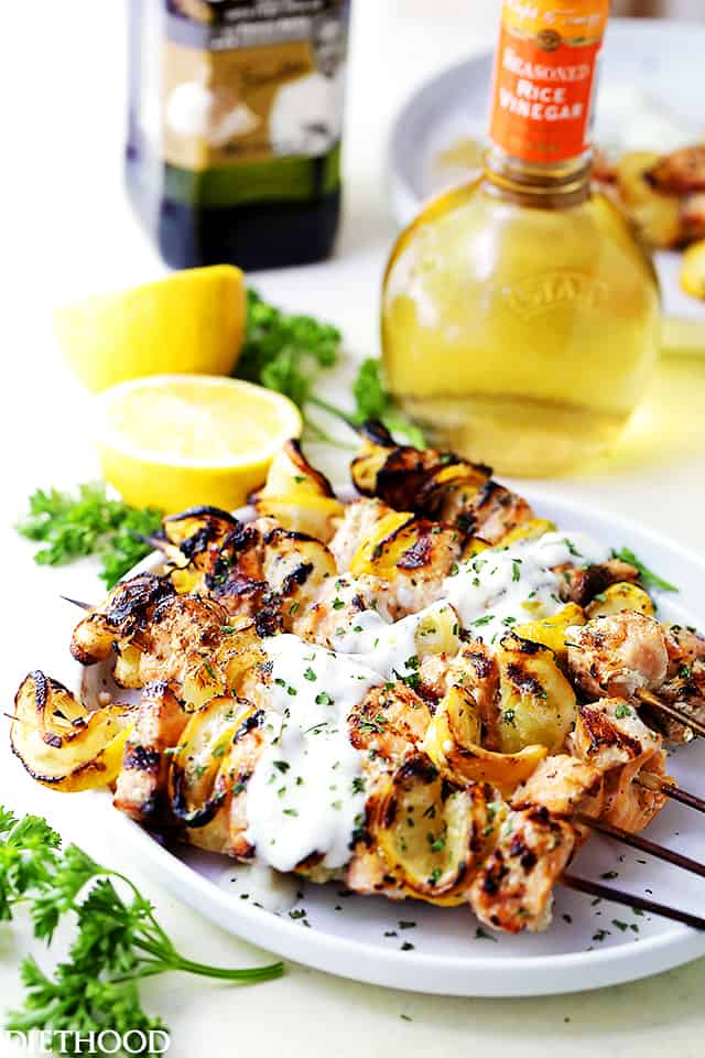 Grilled Salmon Kabobs with Garlic Yogurt Sauce - Tender and moist, these grilled salmon kabobs are juicy with incredible flavor and are served with an amazing garlic yogurt sauce.