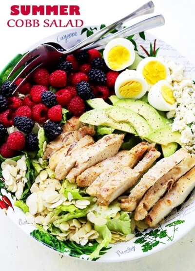 Summer Cobb Salad - Tossed with Italian Dressing, this Cobb Salad is packed with sweet berries, avocado, blue cheese, eggs, and grilled chicken, making it the perfect meal salad for you and your family.