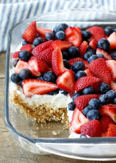 A square baking dish of Berry Pretzel Dessert with crumbly crust, a creamy layer, and berries on top