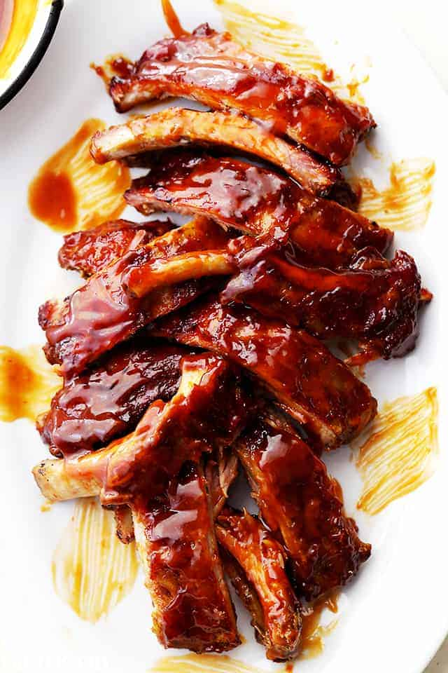 A Plate Filled with Baby Back BBQ Ribs and Homemade Honey Barbecue Sauce