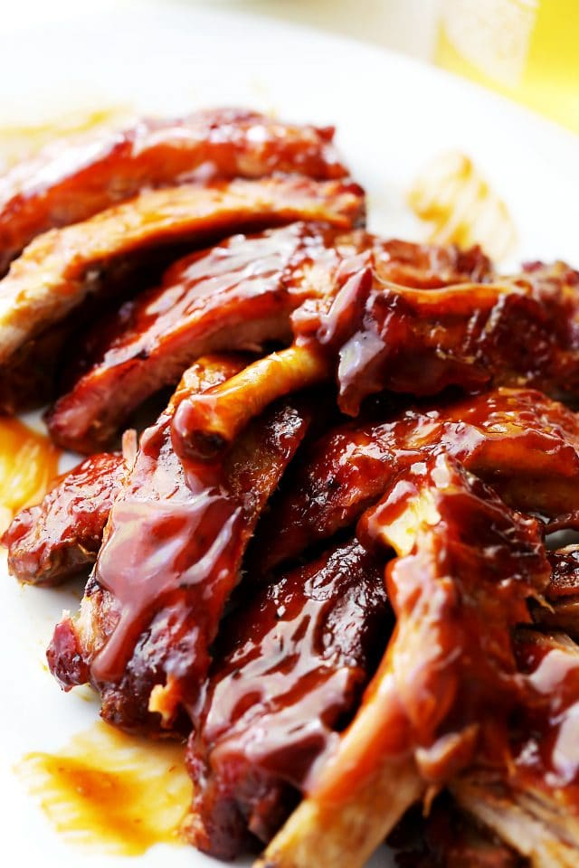 Barbecue Ribs Recipe - The perfect recipe for smokey, spicy and sweet barbecue ribs. They're so flavorful and tender, it will be your new go-to recipe for ribs!