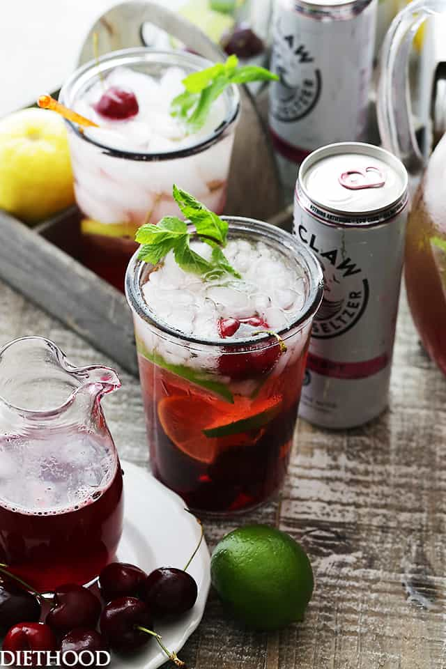Black Cherry Spritzer - A sweet and refreshing mixture of homemade cherry syrup paired with a black cherry flavored seltzer water. Serve this up at your next summer gathering and watch it all disappear!