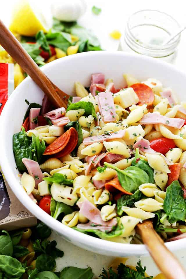Pasta Salad tossed in a white salad bowl.