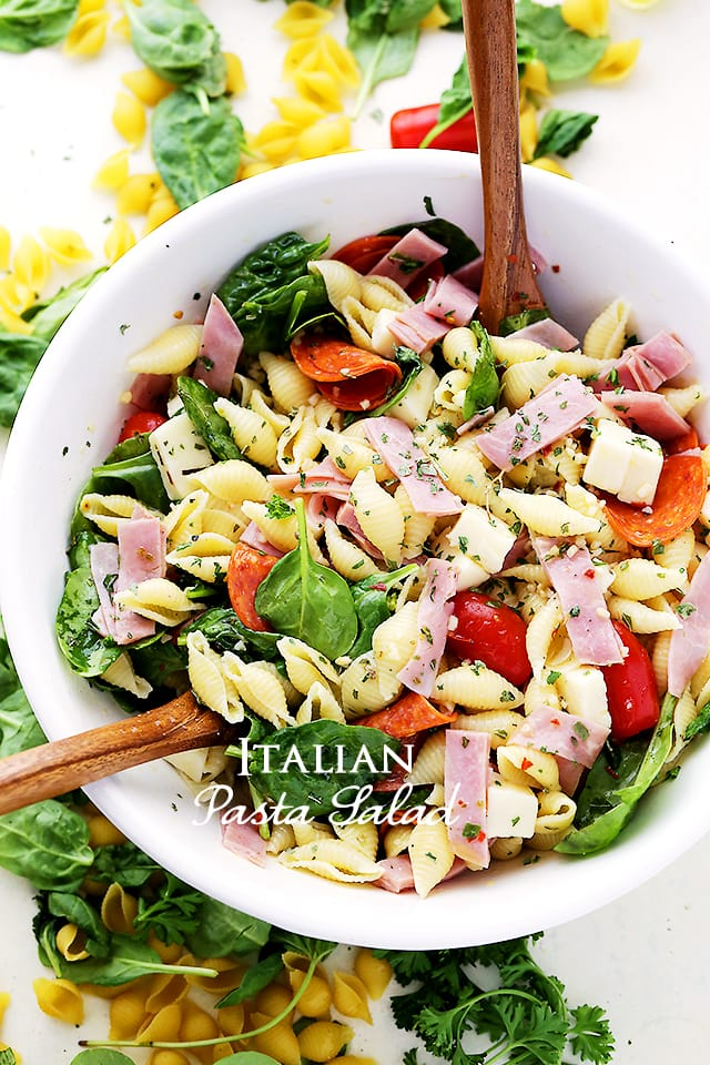 Italian Pasta Salad in a bowl with ham, pepperoni, and cheese.