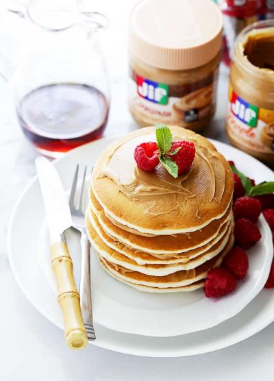 Maple Peanut Butter Pancakes - A quick and simple breakfast with Maple Peanut Butter Spread smeared over sweet and delicious pancakes.