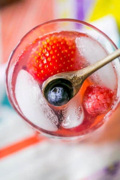 Top view of a glass of sparkling berry lemonade with ice