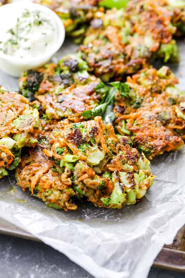 Garlicky and Cheesy Broccoli Fritters - Delicious and crispy fritters loaded with broccoli, carrots, garlic and cheese. Perfect as a side dish, a snack, or an appetizer!