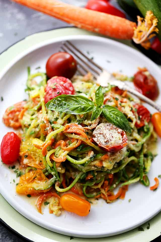 """Carrot and Zucchini Noodles in Light Alfredo Sauce - Quick, easy, and healthy dish with carrots and zucchini """"noodles"""" tossed in a light alfredo sauce. Fresh and delicious!"""