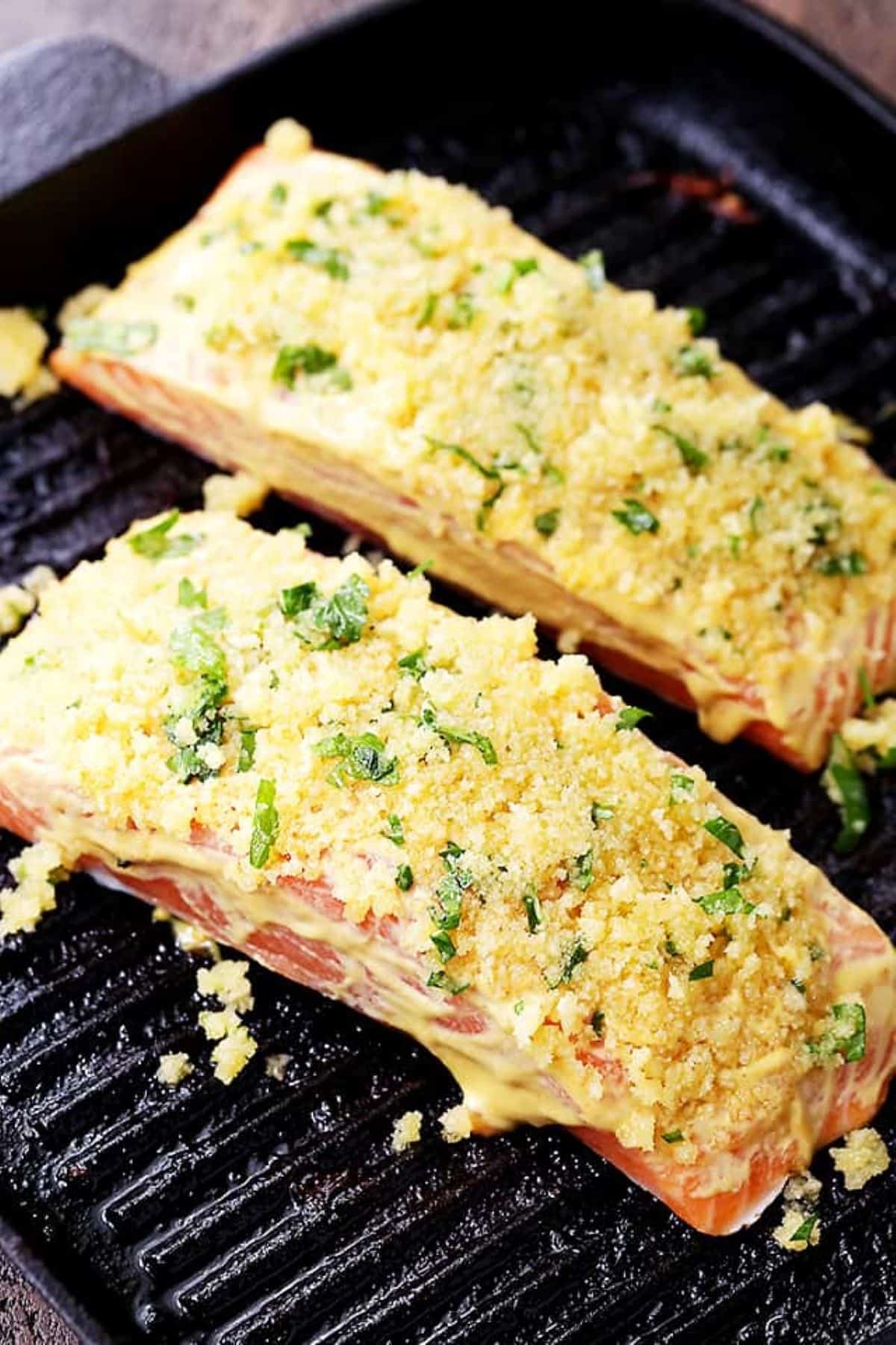 Sliced raw salmon fillets with honey mustard and panko crumbs.