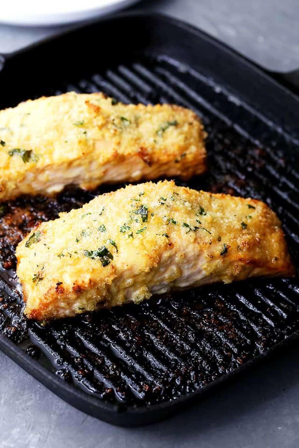 Honey mustard baked salmon on grill pan.