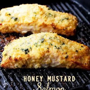 Honey Mustard Salmon - Flavorful and juicysalmon fillets brushed with tastyhoney mustard and coated with a deliciously crunchy crumb topping.