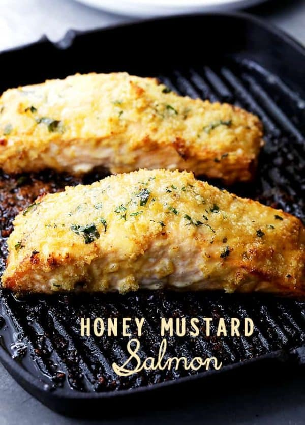 Honey Mustard Salmon - Flavorful and juicy salmon fillets brushed with tasty honey mustard and coated with a deliciously crunchy crumb topping.