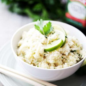 "Coconut Lime Cauliflower ""Rice"" - Cauliflower rice cooked in coconut milk and loaded with fresh lime juice and lime zest! This is the ideal low-carb side dish to any meal!"