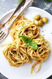 Olive Pesto Pasta Recipe - Quick and easy pasta dinner tossed in a homemade olive pesto made with pimiento-stuffed olives, fresh basil, and sun-dried tomatoes.