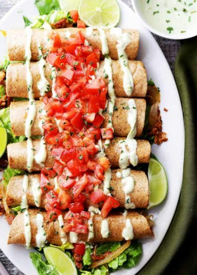 Oven Baked Pulled Pork Flautas with Avocado Crema - Flavorful BBQ pulled pork wrapped in baked flour tortillas and served with an incredible Avocado Crema.