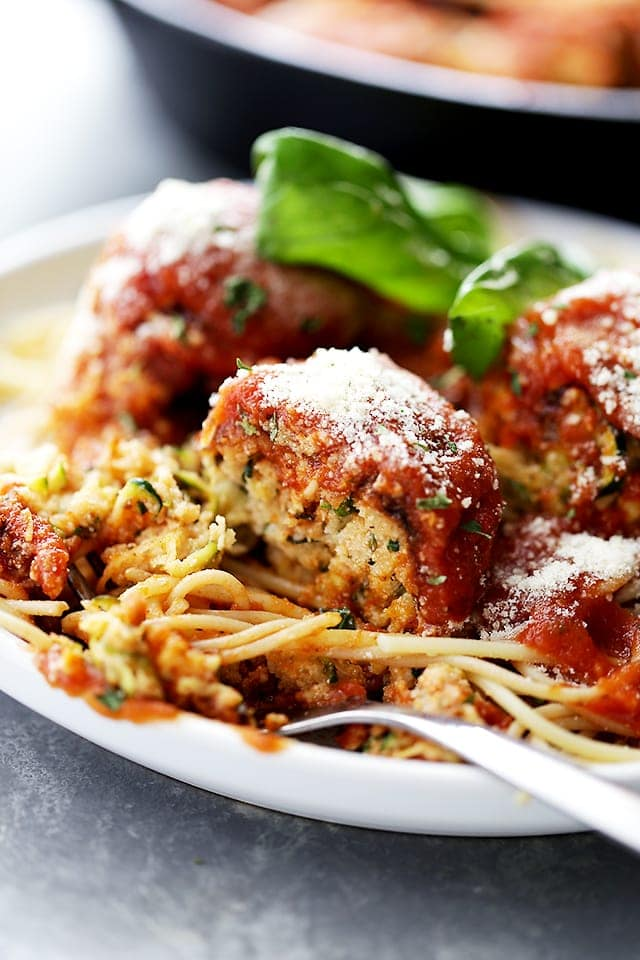 "Ricotta Zucchini ""Meatballs"" - Delicious, melt-in-your-mouth-amazing zucchini meatballs with ricotta and parmesan cheese, topped with a warm and bubbly tomato sauce!"