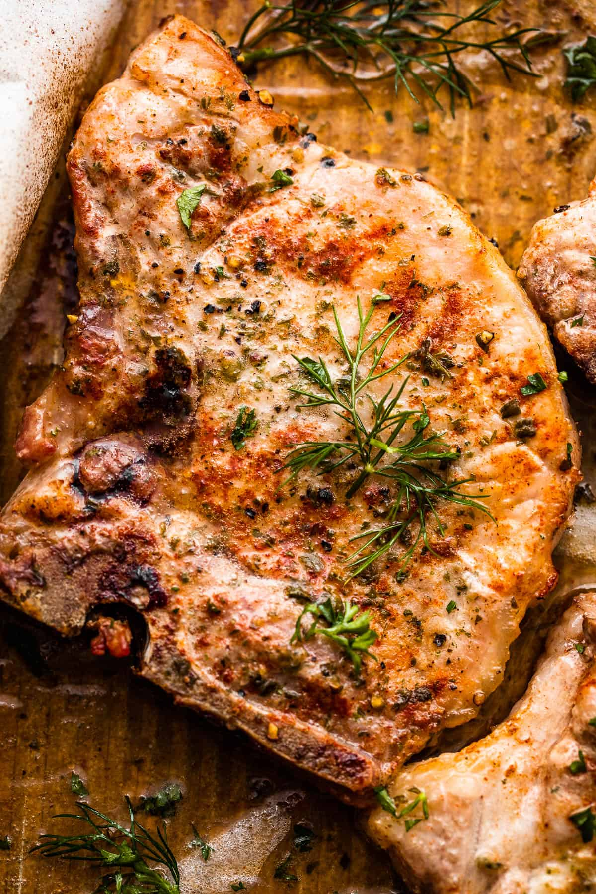 close up photo of one pork chop seasoned with ranch seasoning mix