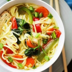 Asian Chicken Noodle Soup - A flavorful and delicious twist on the classic Chicken Noodle Soup featuring ginger, teriyaki sauce, egg noodles, and colorful vegetables, and it's ready in about 30 minutes!