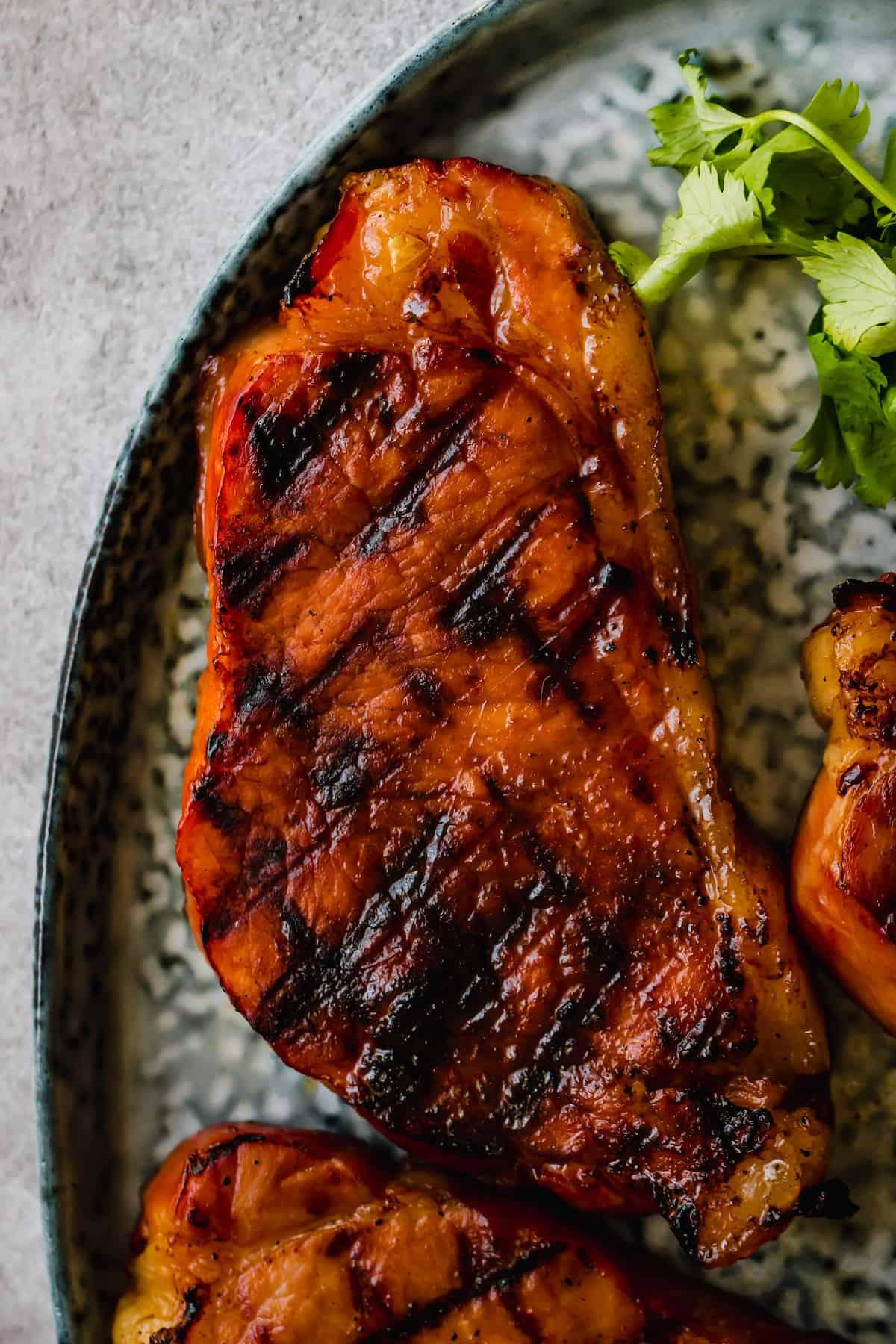Honey soy pork chops on a plate.