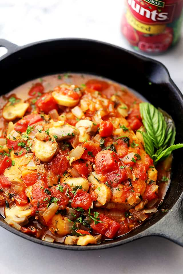 Chicken Marengo - Saucy, a little spicy, and a whole lot delicious French-inspired chicken dish topped with tomatoes and mushrooms!