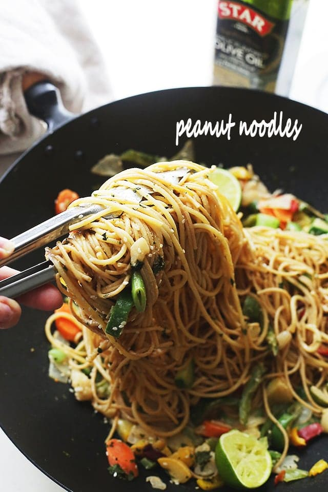 Garlic Peanut Noodles Recipe - Delicious noodles and stir fried vegetables are tossed in garlic olive oil and coated in a mixture of peanut butter, soy sauce, lime juice, hot sauce and ginger.
