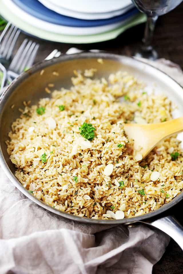 Almond Brown Rice Pilaf - Turn simple brown rice into a delicious healthy dish with toasted almonds, sweet shallots and parsley!