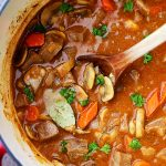 Beer Beef Stew Recipe - Super easy, but delicious and quick hearty stew cooked in a dutch oven with beef, mushrooms, carrots, and beer!