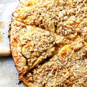 Gluten Free Caramel Apple Pizza with Streusel Topping - A delicious dessert pizza featuring a gluten free pizza crust, apples, a drizzle of caramel, and a sweet and crumbly streusel topping.