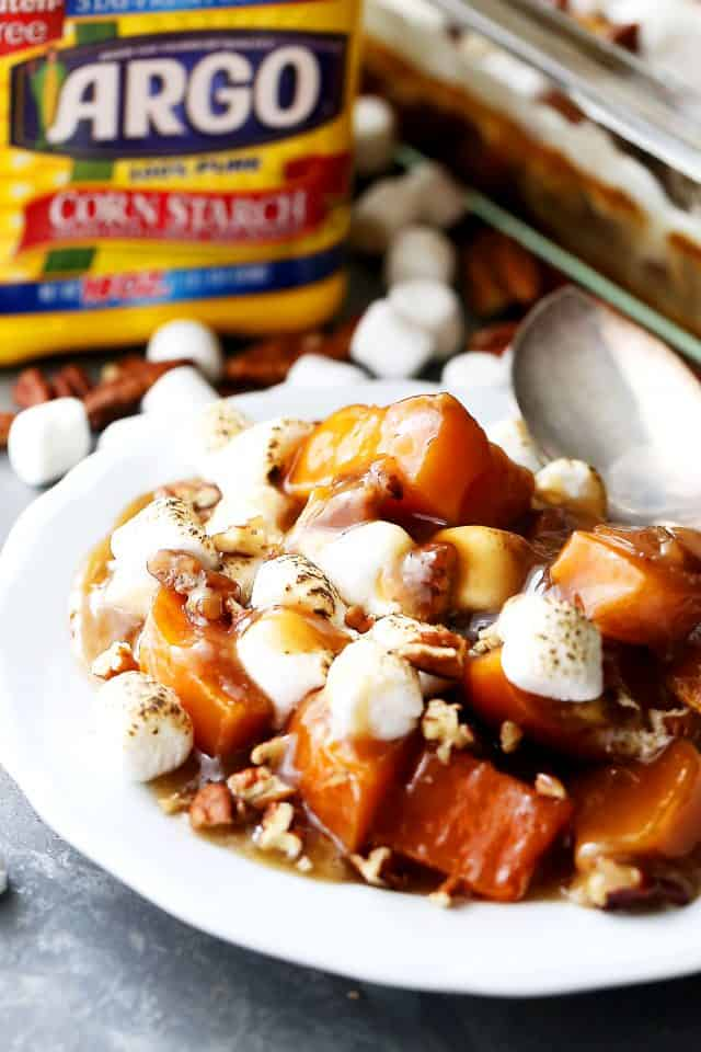 Orange and Pecans Sweet Potato Casserole - Delicious chunks of sweet potatoes baked in a luscious orange sauce, and topped with creamy marshmallows and crunchy pecans.