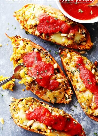 Basil Pesto Twice-Baked Sweet Potatoes - Twice baked, savory sweet potatoes stuffed with a delicious basil pesto mixture, and topped with melty mozzarella cheese and marinara!