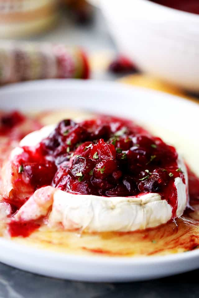 Cranberry Sauce Topped Baked Brie - Warm, cheesy and gooey baked brie topped with cranberry sauce!
