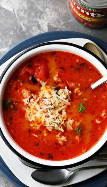 A Large Bowl of Taco Soup Garnished with Shredded Mozzarella Cheese on a Countertop