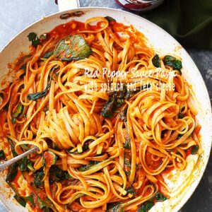 Red Pepper Sauce Pasta with Spinach and Feta - A perfect weeknight meal featuring sweet red peppers blended into a delicious and healthy sauce tossed with fettuccine pasta, spinach and feta cheese.