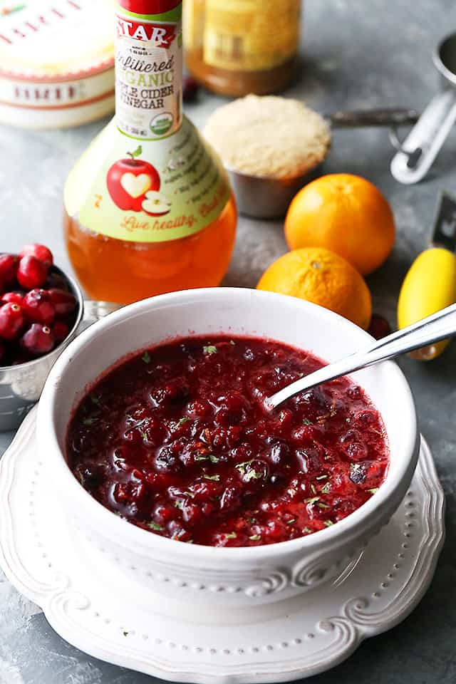 Slow Cooker Spiced Cranberry Sauce - Prepared in the slow cooker, this easy and soon to be your new favorite cranberry sauce recipe features fresh, ruby red cranberries, cinnamon, ginger, cloves, orange juice and apple cider vinegar.