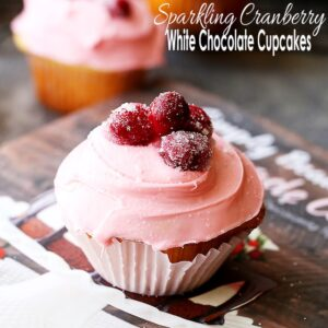 Sparkling Cranberry White Chocolate Cupcakes - Perfectly moist cupcakes filled with a creamy white chocolate ganache, and topped with a fresh cranberry frosting and sugared cranberries!