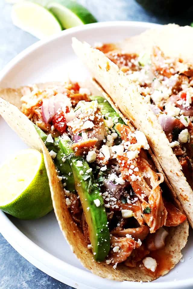 Slow Cooker Salsa Chicken Tacos - Packed with amazing flavors, healthy, and very easy to make Salsa Chicken Tacos! Arrange all ingredients in the crock pot and walk away!