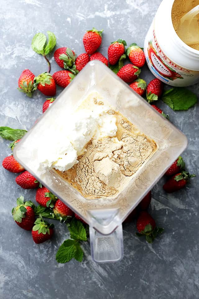 Strawberry Cheesecake Protein Shake - This amazing protein shake is just as delicious as a slice of strawberry cheesecake, BUT this is way healthier and it's packed with protein!