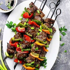 Asian Beef Skewers - An amazing sweet and savory marinade lends an amazing flavor to these delicious beef skewers!
