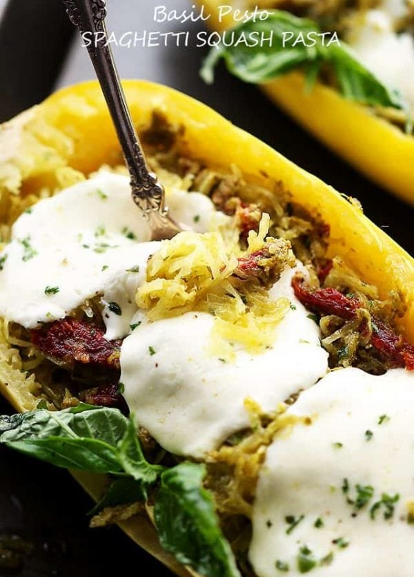 Basil Pesto Spaghetti Squash Pasta - An easy and healthy spaghetti squash pasta dinner tossed with basil pesto and sun dried tomatoes.